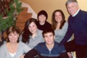 Photo of Amy and Alan Meltzer with family. Link to their story.