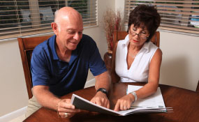 Photo of a man and woman looking at a brochure